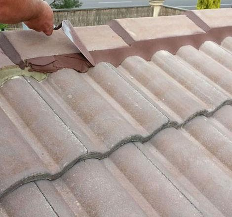 Repointing roof cap to prevent damp