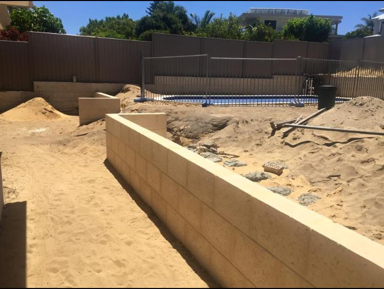how much does a concrete retaining wall cost. Black Bedroom Furniture Sets. Home Design Ideas