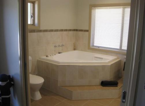 Corner Bath Ideas by Cadox Building Design Pty Ltd