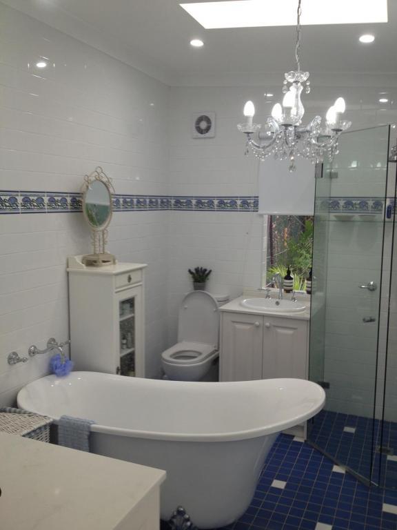 Bathroom Tile Design Ideas by Mystique Interior Design