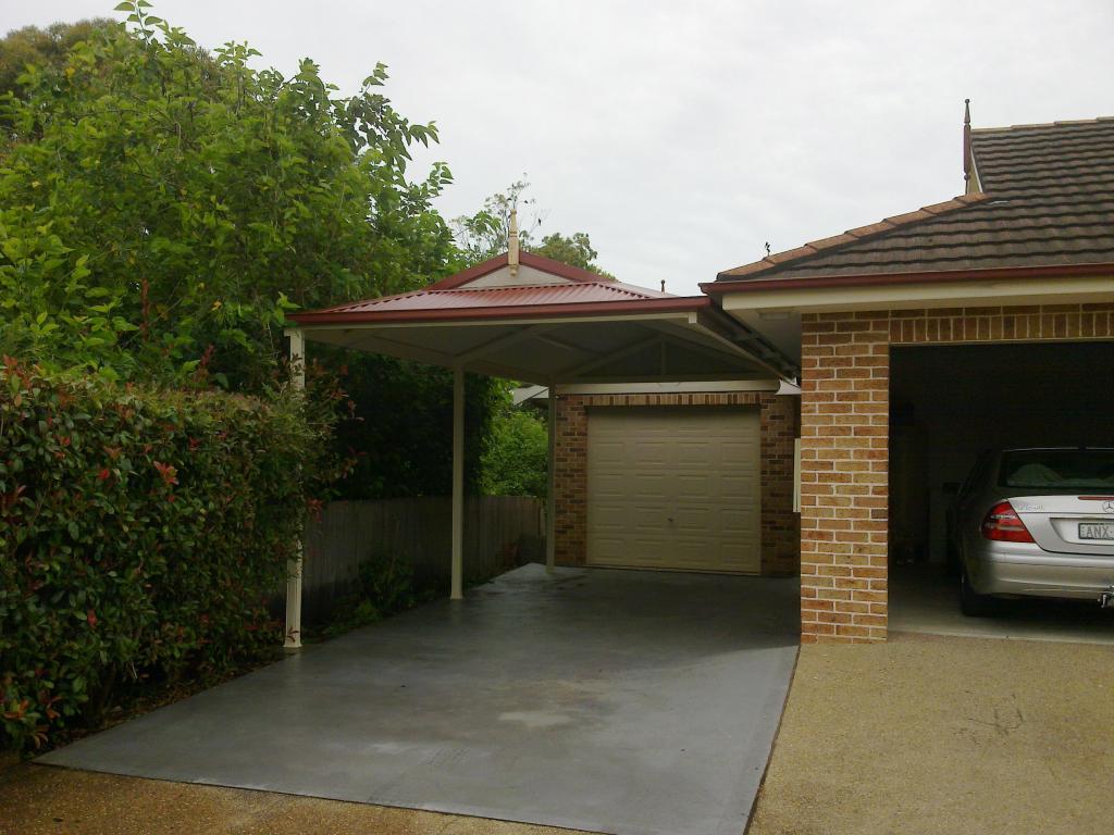 Attached carport gravel floor log garage carport for Carport attached to side of garage