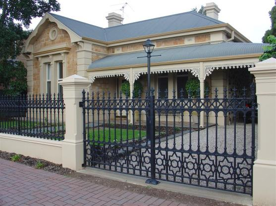 Fence design ideas get inspired by photos of fences from for Brick and wrought iron fence designs