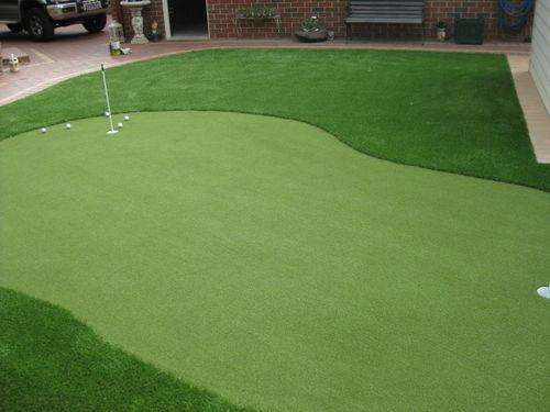 Artificial putting green in a residential front garden