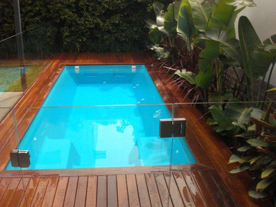 Pool decking design ideas get inspired by photos of pool for Above ground pool landscaping ideas australia