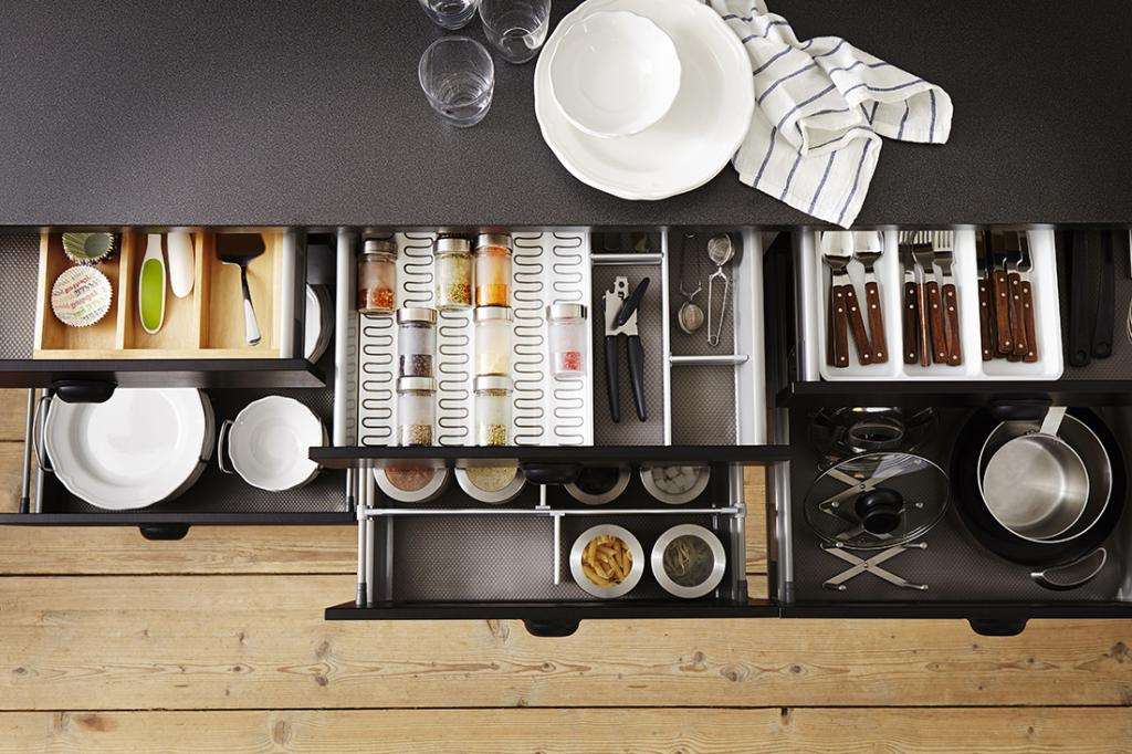 top down picture of flatpack kitchen cutlery, plates ans spice draws