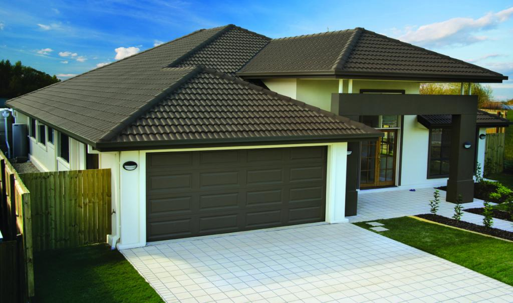 Metal or tile roof for Tin roof house designs