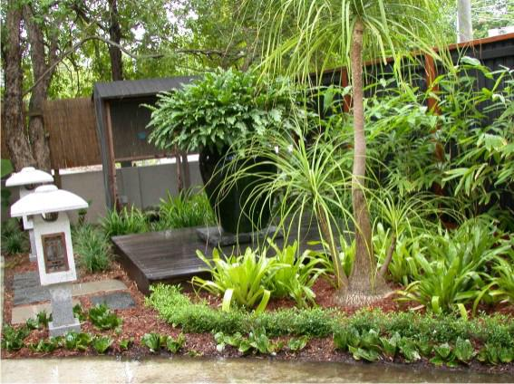 Style ideas gardens the tropical garden steven clegg for Garden designs queensland