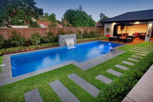Pool design ideas get inspired by photos of pools from for Landscaping ideas for pool areas