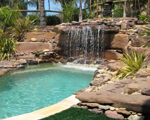 Pool design ideas get inspired by photos of pools from for Pool landscaping pictures