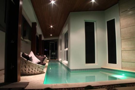 Indoor pool design ideas get inspired by photos of for Domestic swimming pool design