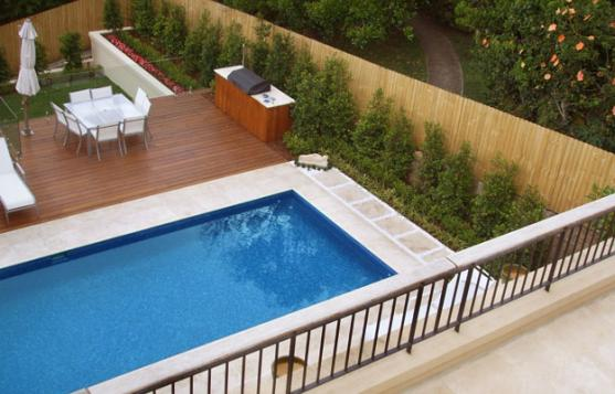 Pool design ideas get inspired by photos of pools from for Swimming pool landscaping ideas