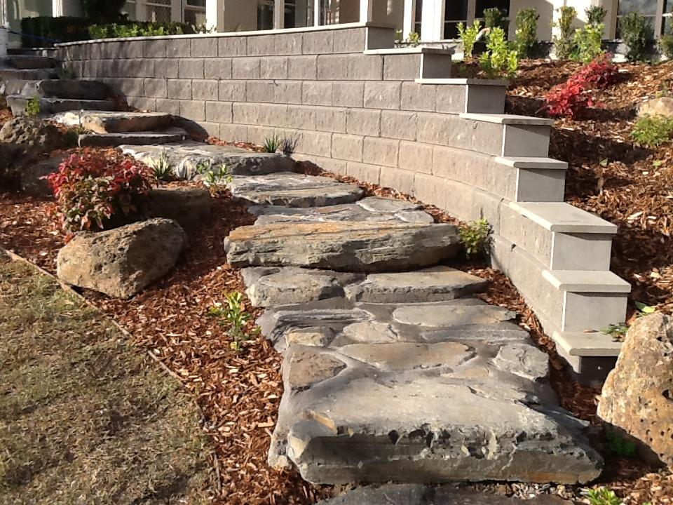 completed retaining wall next to garden steps