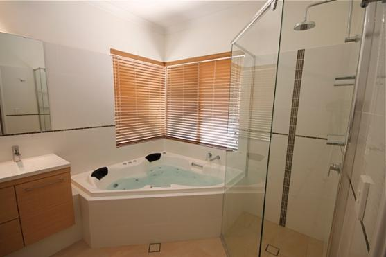 Corner Bath Ideas by Funkis Renovations