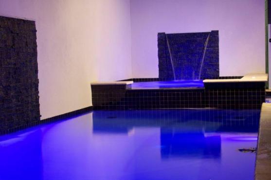 Swimming Pool Designs by J.H. Pools & Spas