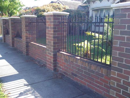 Brick fencing design ideas get inspired by photos of for Brick and wrought iron fence designs