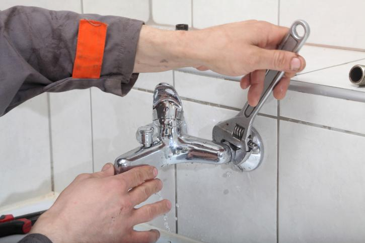 plumber changing washers taps