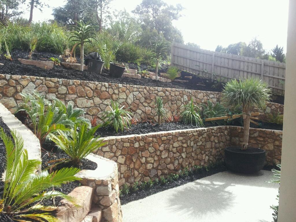 Quality stone retaining walls all areas byron for Retaining wall contractors adelaide