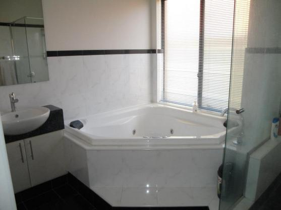 Corner Bath Ideas by Ausmak Holdings Pty Ltd
