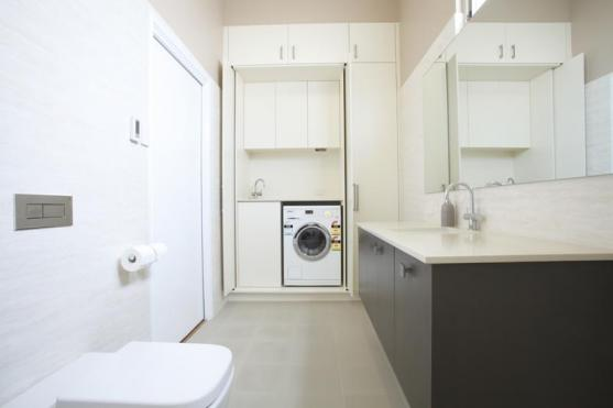 Laundry design ideas get inspired by photos of laundry for Small bathroom laundry designs