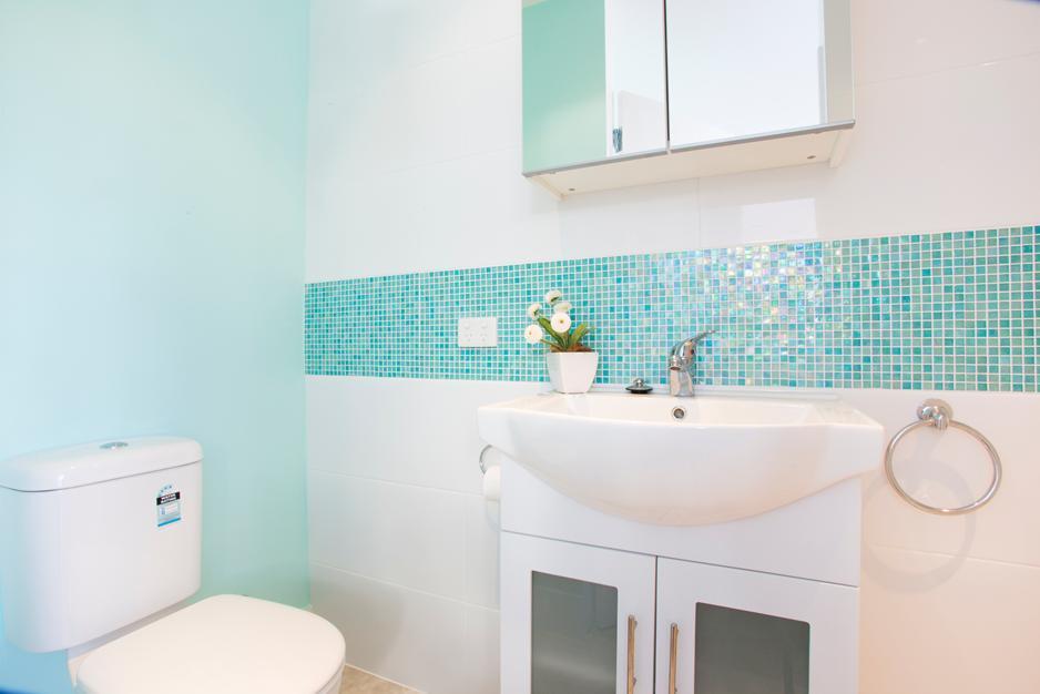 Bathroom Tile Design Ideas by KAD Building Solutions