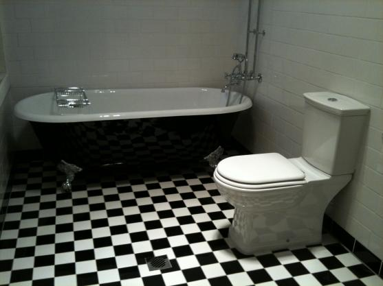Bath Designs  by Dimension Renovation Co.