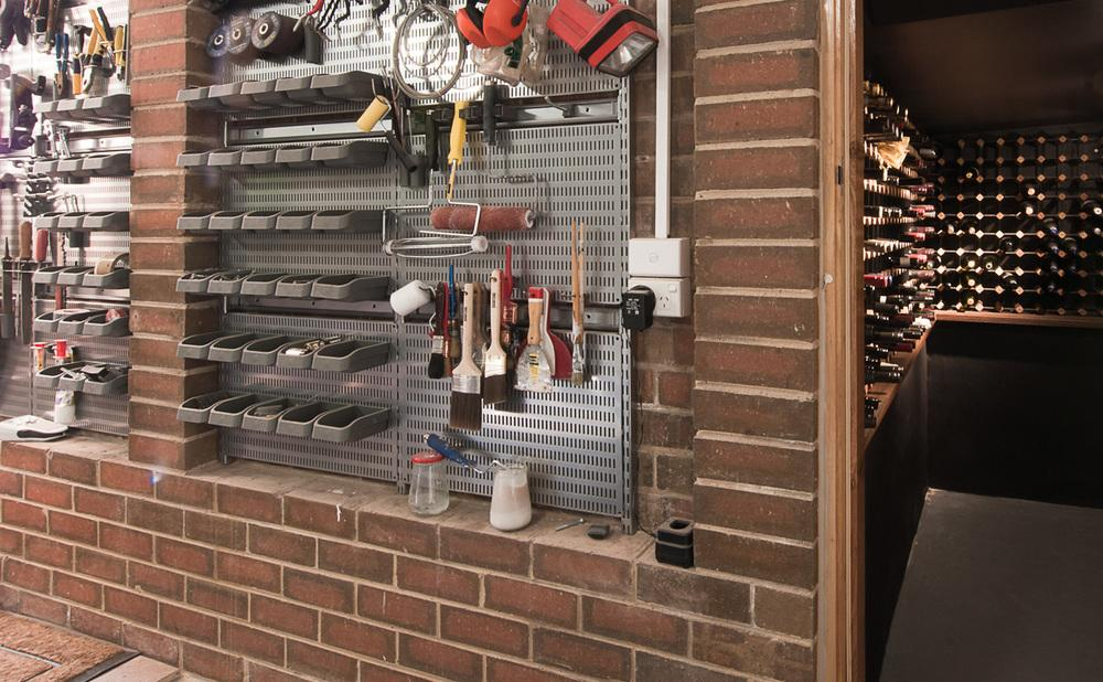 DIY a garage storage solution with baskets and hooks
