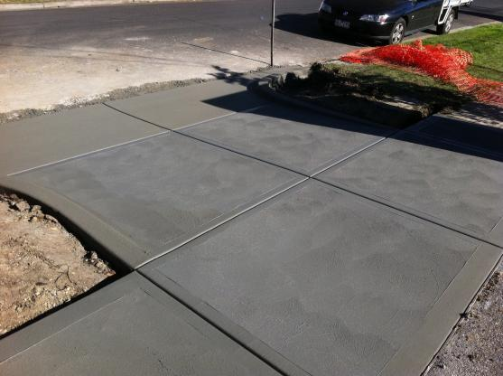 after the stain is applied a bare concrete surface can look like natural stone and have a deep lasting colour and texture swirling patterns emerge that - Concrete Driveway Design Ideas