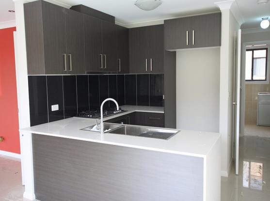 Kitchen Tile Design Ideas by Austra Construction