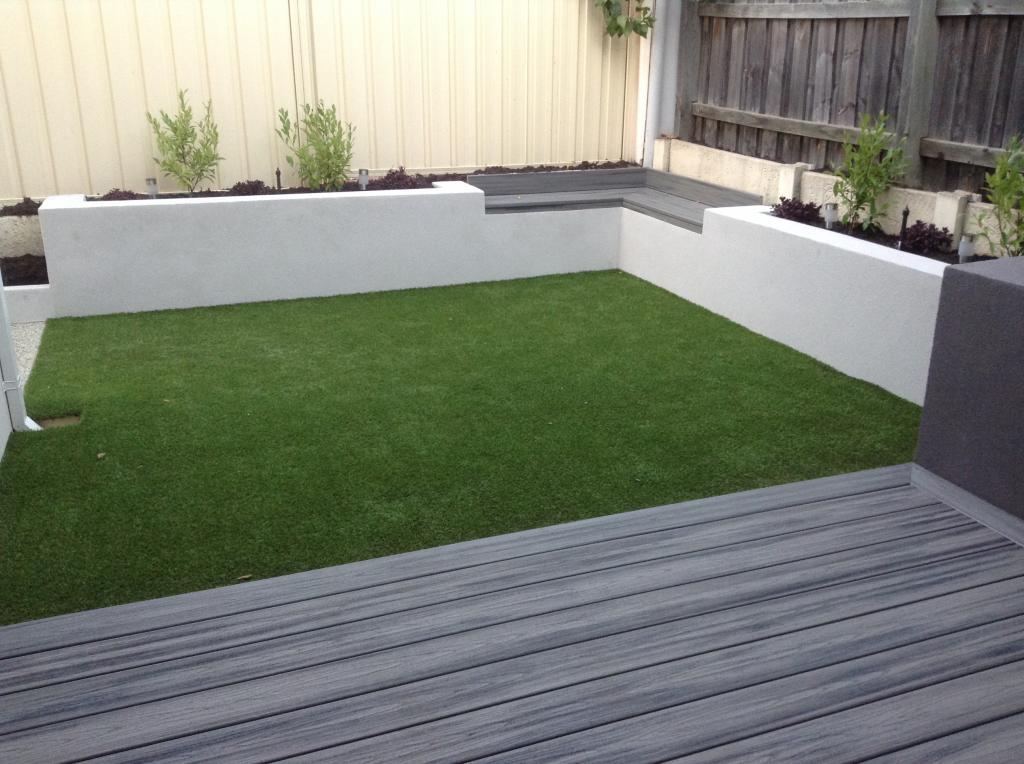 How to turn a tiny courtyard into a multi functional for Garden decking with artificial grass